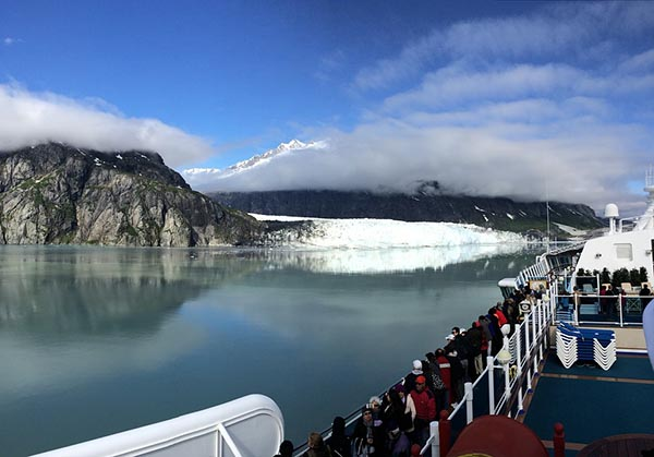 Cruise passengers take in the Alaskan scenery from their ship.